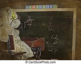 Old School - Teddybear sitting at an old school desk with...