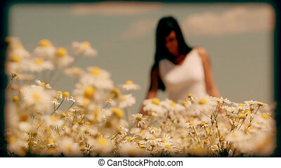 Old school video - Young woman walking in the meadow,...