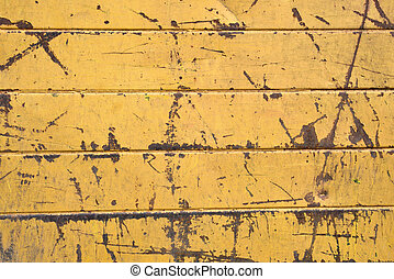 Old scratched yellow color metal plate