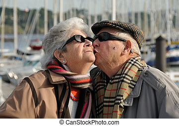 Old senior man kissing his wife