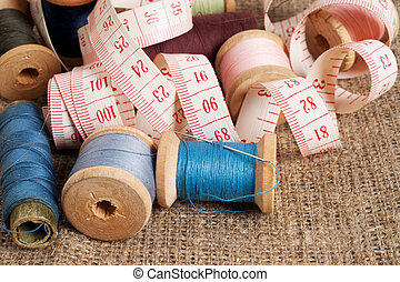 Old sewing items on canvas background