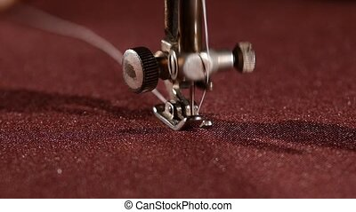 Old sewing machine on vinous cloth, close up, slow motion