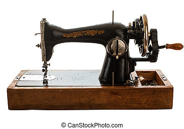 Old sewing machine on white background.