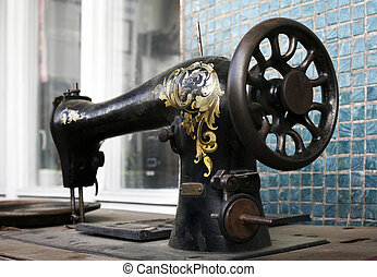 Old sewing machine - This shows the hand painted detail of...