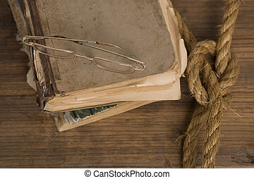 old shabby book and glasses