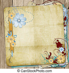Old shabby style  photoalbum with paper frames for photos