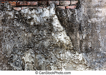 Old shabby wall cement cracks it is visible brickwork.