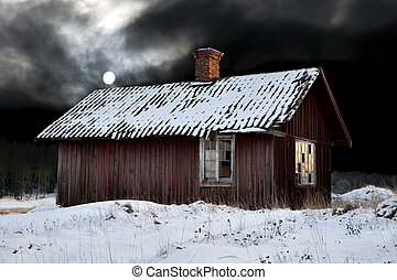 Old shack in winter evening with moonshine