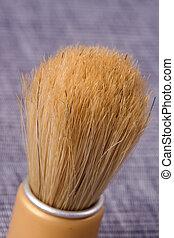 old shaving brush on blue background