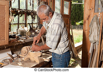 Old shed and skilled carpenter - Old shed with a skilled...