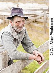 Old shepherd man smoking reflexive