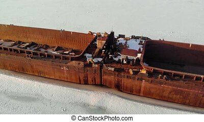 old ship, barge, on a frozen river, aerial shooting - old...