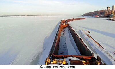 old ship, barge, on a frozen river, aerial shooting
