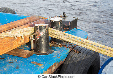Old ship moored with bollard and ropes