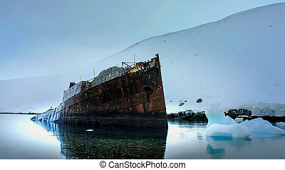 Old ship wreck at shore in Antarctica.