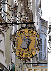 Old shop sign for Trachten Seidl made of wrought iron,...