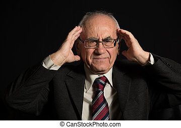 old sich businessman - older businessman, wearing eyeglasses...