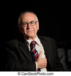 old sich businessman - older businessman, wearing eyeglasses...