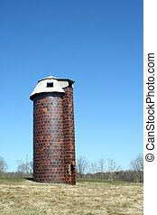 A old silo against blue sky
