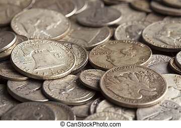 Old Silver Coins - The Liberty Bell is shown on a coin pile...
