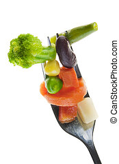 Old silver plug and small slices of vegetables isolated on white macro. Correct vegetable diet concept