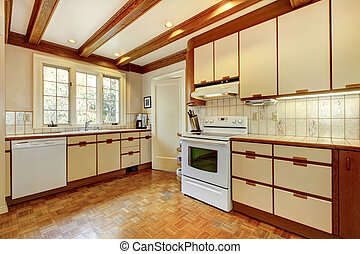 Old simple white and wood kitchen with hardwood floor.