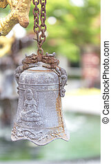 Old small bells - small bells inside the park. Vertical...