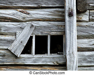 Old small window in wooden house