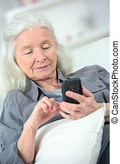old smiling woman with mobile phone