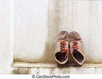 Old sneakers on the background wall.