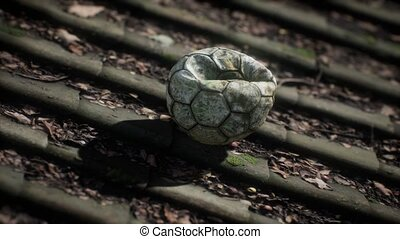 old soccer ball on the roof of a house
