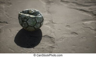Old soccer ball the cement floor