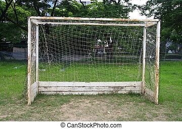 Old soccer goal in field