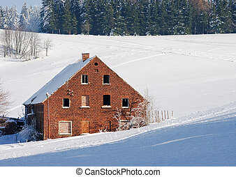 Old solitary brick cottage during the winter