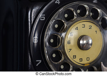 Old Soviet dialing telephone dial, close-up