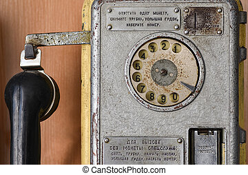 Old Soviet telephone payphone with a disk dialer, call special services, retro, close up