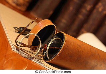 Old spectacles - Closeup of old spectacles inside leather...
