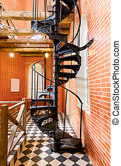 old spiral staircase made of cast iron in the water tower
