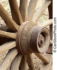 Old Spokes - Wood spokes and hub on weather worn antique...