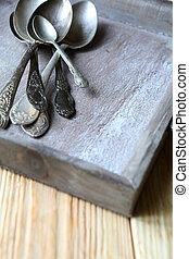 old spoons in a wooden tray, food close up