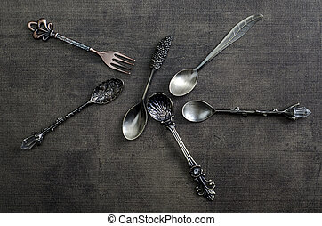 Old spoons on wooden background