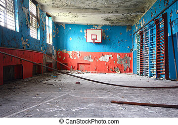 old sports hall at school with a basketball