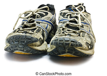 old sports shoes - old dirty sports shoes in front view. Low...