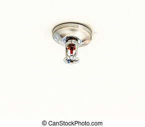 Old sprinkler system on the ceiling of home office.