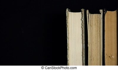 Old stack of books standing in a nu