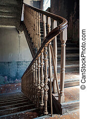 Old stairs in abandoned building - Old vintage stairs with...