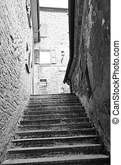 Old stairs on medieval narrow street