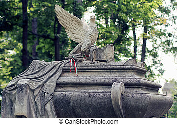 Old statue on grave in the Lychakivskyj cemetery of Lviv, Ukrain