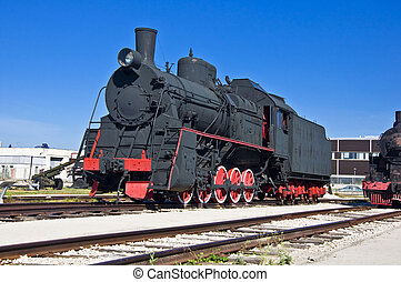 Old steam locomotive at the depot. Museum of Technology in Togliatti.