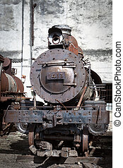 old steam locomotive on the background wall
